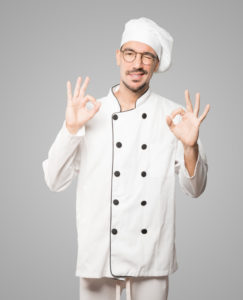 surprised-young-chef-with-gesture-approval_1459-15812